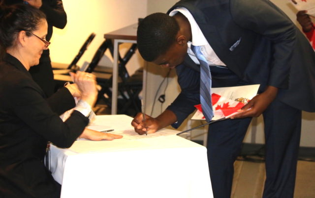 Endurance Osaghae, born in Nigeria, was one of the new citizens who took their oath of citizenship at a special citizenship ceremony at the BMO Field in Toronto.