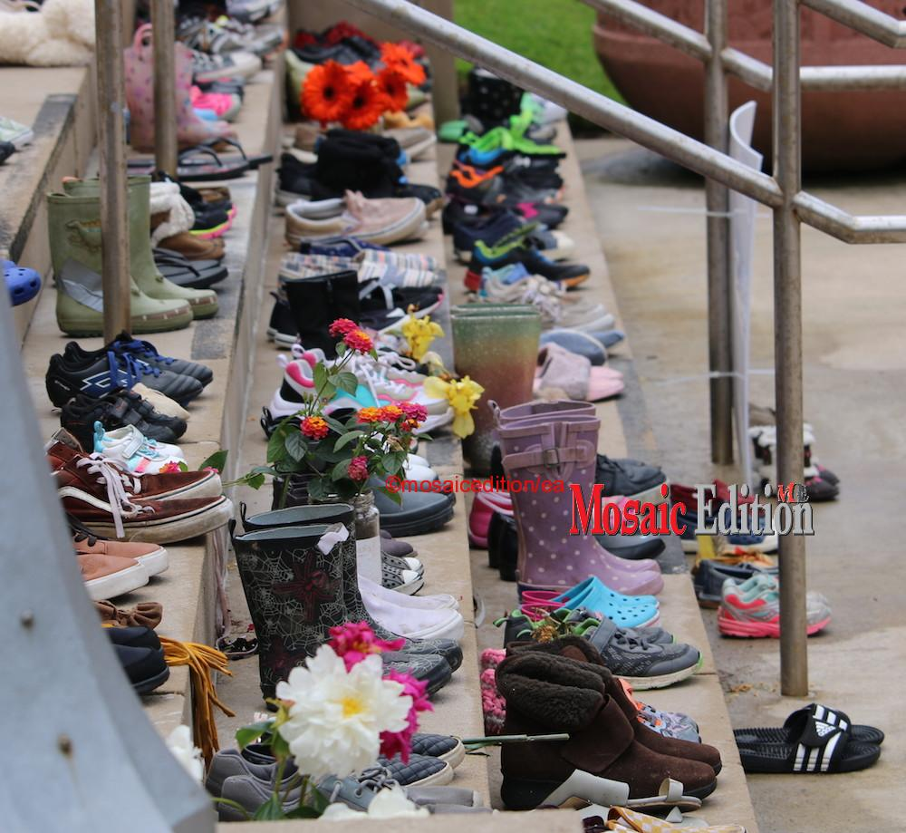 Shoes on the steps of City Hall St. Catharines - Special ceremony to remember the 215 Indigenous children whose remains were found recently in unmarked graves took place June 8, 2021 in St. Catharines. Photo Mosaic Edition Edward Akinwunmi