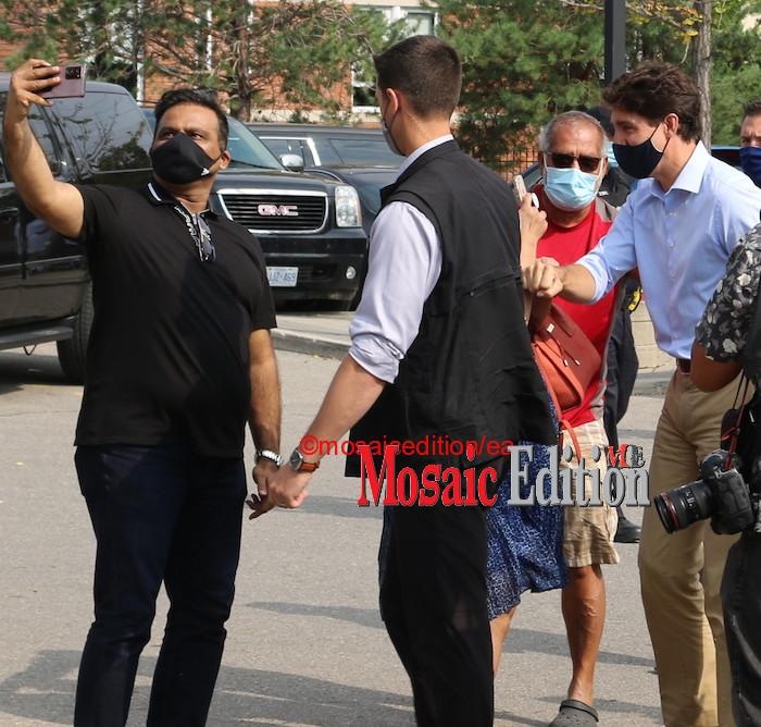 Justin Trudeau was not distracted as he bump elbows, smiled, and took selfies with his supporters. Photo Mosaic Edition Edward Akinwunmi