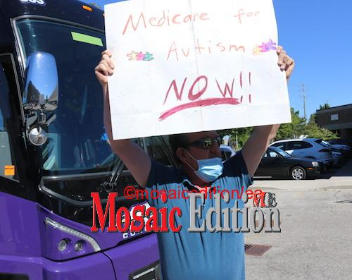 Protester at O'Toole event in Markham - OHIP should cover Autism. Photo Mosaic Edition Edward Akinwunmi
