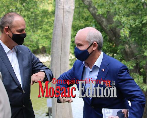 Erin O'Toole bumps elbow with Conservative Party candidate Michael Ras – Mississauga Lakeshore. Pandemic greeting - photo Mosaic Edition Edward Akinwunmi