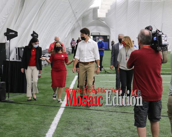 Trudeau in discussion with Chrystia Freeland, Minister of Finance. Photo Mosaic Edition Edward Akinwunmi