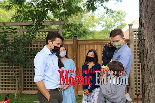 Trudeau greets family at backyard meet in Mississauga. Photo Mosaic Edition Edward Akinwunmi