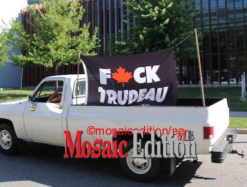 Windsor - September 17, 2021 - Flag emblazoned with expletive at the back of an old, white, pickup truck.  Trudeau was in Windsor to thank nursing students at the University of Windsor for stepping up during pandemic. Photo Mosaic Edition Edward Akinwunmi